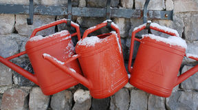 Watering Cans on Wall Royalty Free Stock Images