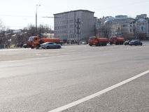 Watering car wash road in Moscow Royalty Free Stock Photo