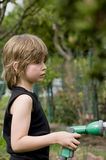 Watering child Stock Photography