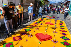 Watering colorful Lent carpet of hearts, Antigua, Guatemala Stock Photography