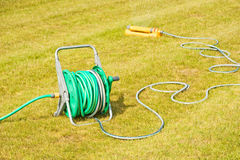 Watering a dry lawn in a drought. Stock Photos