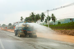 Watering the dust the street. Watering the dust on the street royalty free stock photos