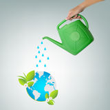 Watering earth ecology concept Royalty Free Stock Image