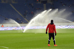 Watering the field at half-time Stock Images