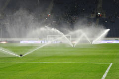 watering field at halftime of match photo was taken during the between fc dnipro dnipropetrovsk city and fc olimpik donetsk city Royalty Free Stock Photography