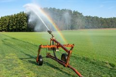 Watering a field Royalty Free Stock Image