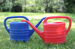 Watering flowers in the garden. With watering can Royalty Free Stock Photography
