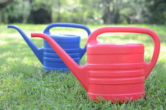 Watering flowers in the garden. With watering can Stock Photo