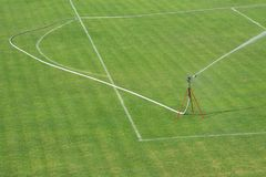 Watering the football court during the season. Watering grass of the football court during the season Stock Photo