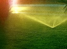 Watering fountain in ray sun. Photography with scene of the watering fountains in ray evening sun as backgrounds Stock Photography