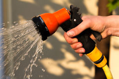 Watering garden equipment - hand holds the Royalty Free Stock Photography
