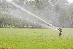 Watering garden equipment sprinkler hose for irrigation plants. Royalty Free Stock Photography