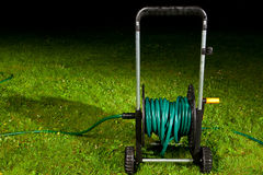 Watering garden hose Stock Photography