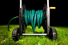 Watering garden hose Royalty Free Stock Photography