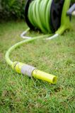 Watering garden hose Royalty Free Stock Images