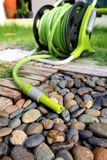 Watering garden hose Royalty Free Stock Image