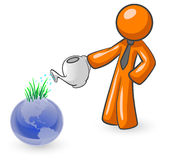 Watering the globe Royalty Free Stock Photography