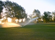 Watering the Golf Course Royalty Free Stock Photography