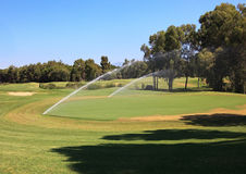 Watering golf courses. Stock Image