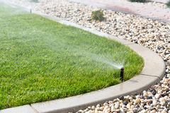 watering grass Royalty Free Stock Photography