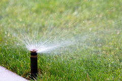 Watering grass Royalty Free Stock Images