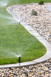 Watering grass Stock Image