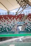 Watering grass on big sport stadium Royalty Free Stock Photo
