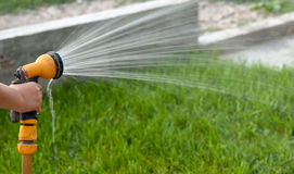 Watering the grass Royalty Free Stock Photo