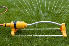 Watering grass equipment. Stock Photo