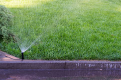 Watering grass Royalty Free Stock Photo
