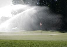 Watering the Green Royalty Free Stock Photo