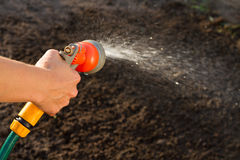 Watering the ground. With spray gun Stock Image