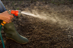 Watering the ground Stock Images
