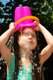 Watering herself royalty free stock image