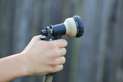 Watering Hose. Close up view of someone watering their yard with their water hose Royalty Free Stock Photo
