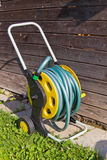 Watering hose in a garden royalty free stock photography