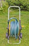 Watering hose in a garden royalty free stock photos