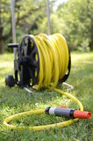 Watering hose. On grass in the garden Royalty Free Stock Photography
