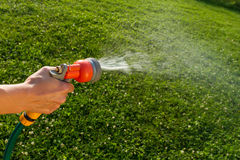 Watering the lawn, close-up Royalty Free Stock Image