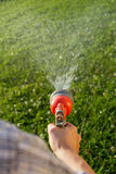 Watering the lawn, close-up Stock Photos
