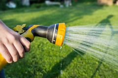 Watering lawn Royalty Free Stock Image