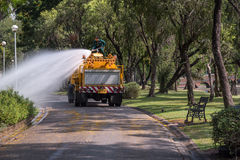 Watering the lawn by water tanker truck Royalty Free Stock Photos