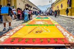Watering Palm Sunday carpet, Antigua, Guatemala Royalty Free Stock Photo