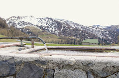 Watering place in the Alps Stock Images
