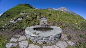 Watering place in Alps mountain. A broad view of a watering place under cloudless sky on a sunny summer afternoon in alps mountains on kietzsteinhorn in kaprun stock images