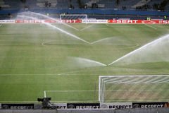 Watering soccer field Royalty Free Stock Photo