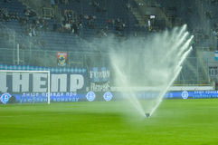 Watering of soccer field Royalty Free Stock Photos