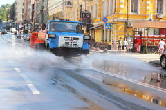 Watering the streets Stock Photography