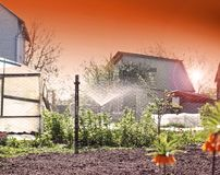 Watering system in the garden royalty free stock photography