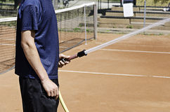 Watering tennis court Stock Photos